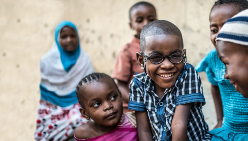 Saidi smiles broadly at the camera, in his brand new glasses.