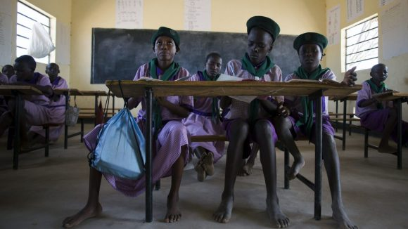 Four girls sitting in a classroom.