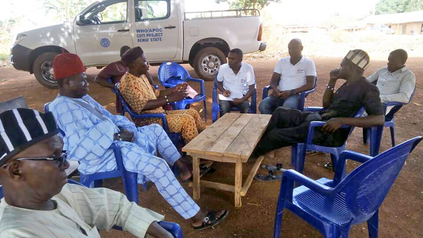 A group of health workers and local leaders.