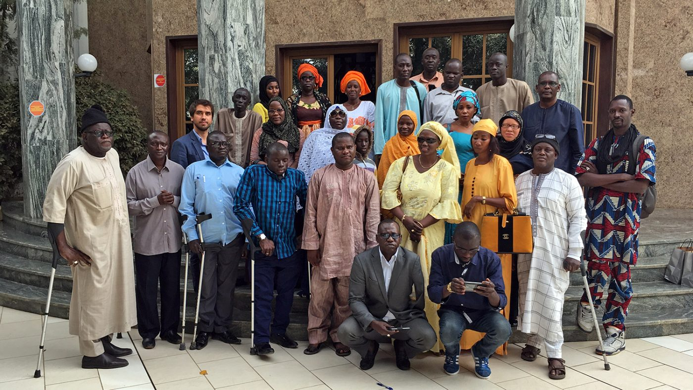 A group of disability advocates pose for a photo following their meeting.