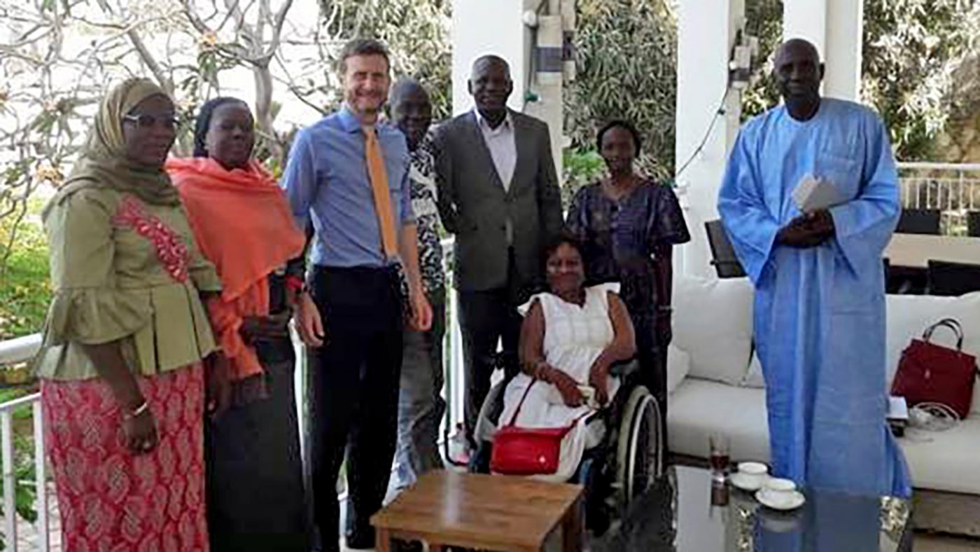 Sightsavers staff with the British Ambassador during their meeting.