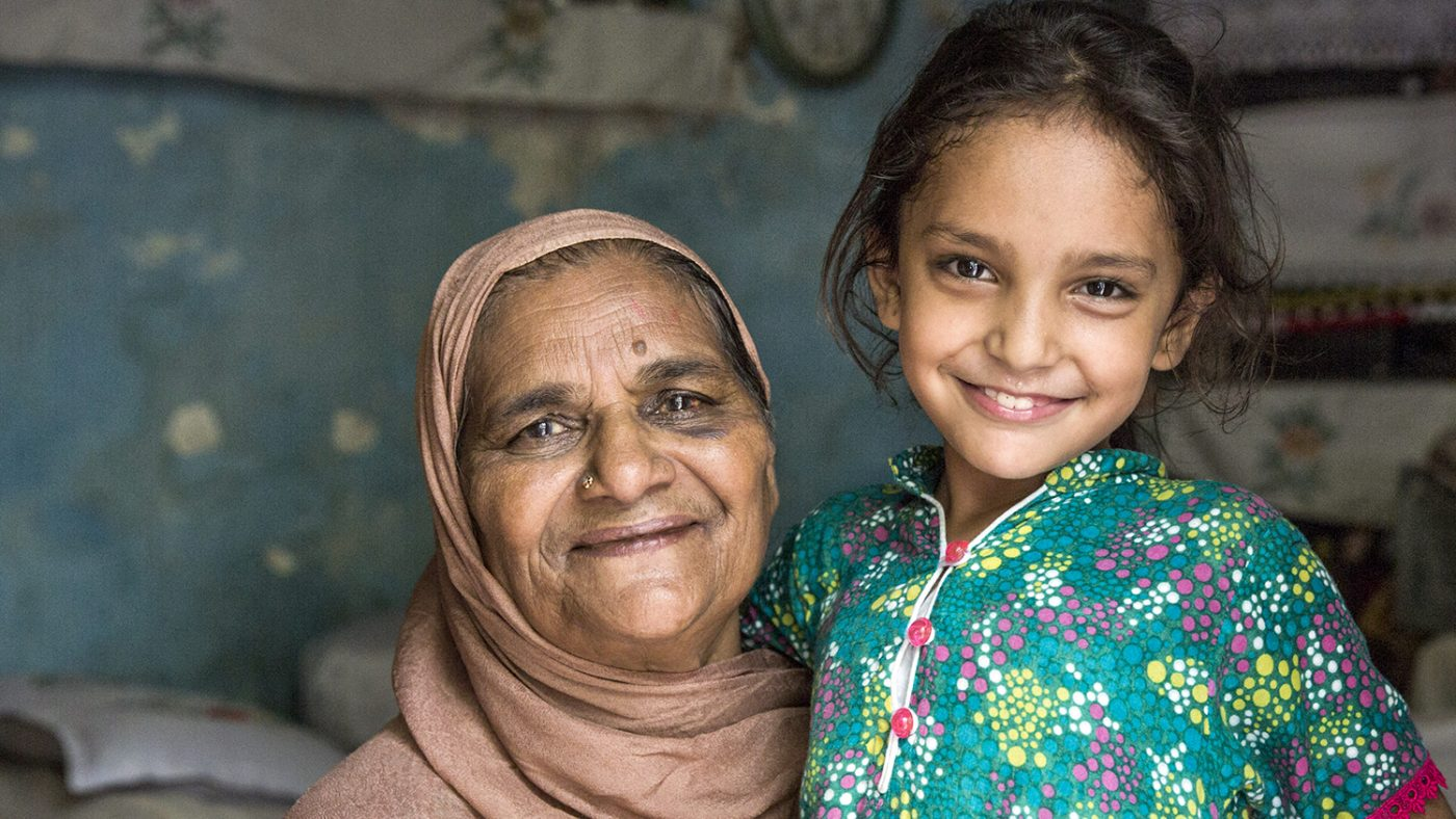 Zamurrad smiles with her daughter following her eye operation.