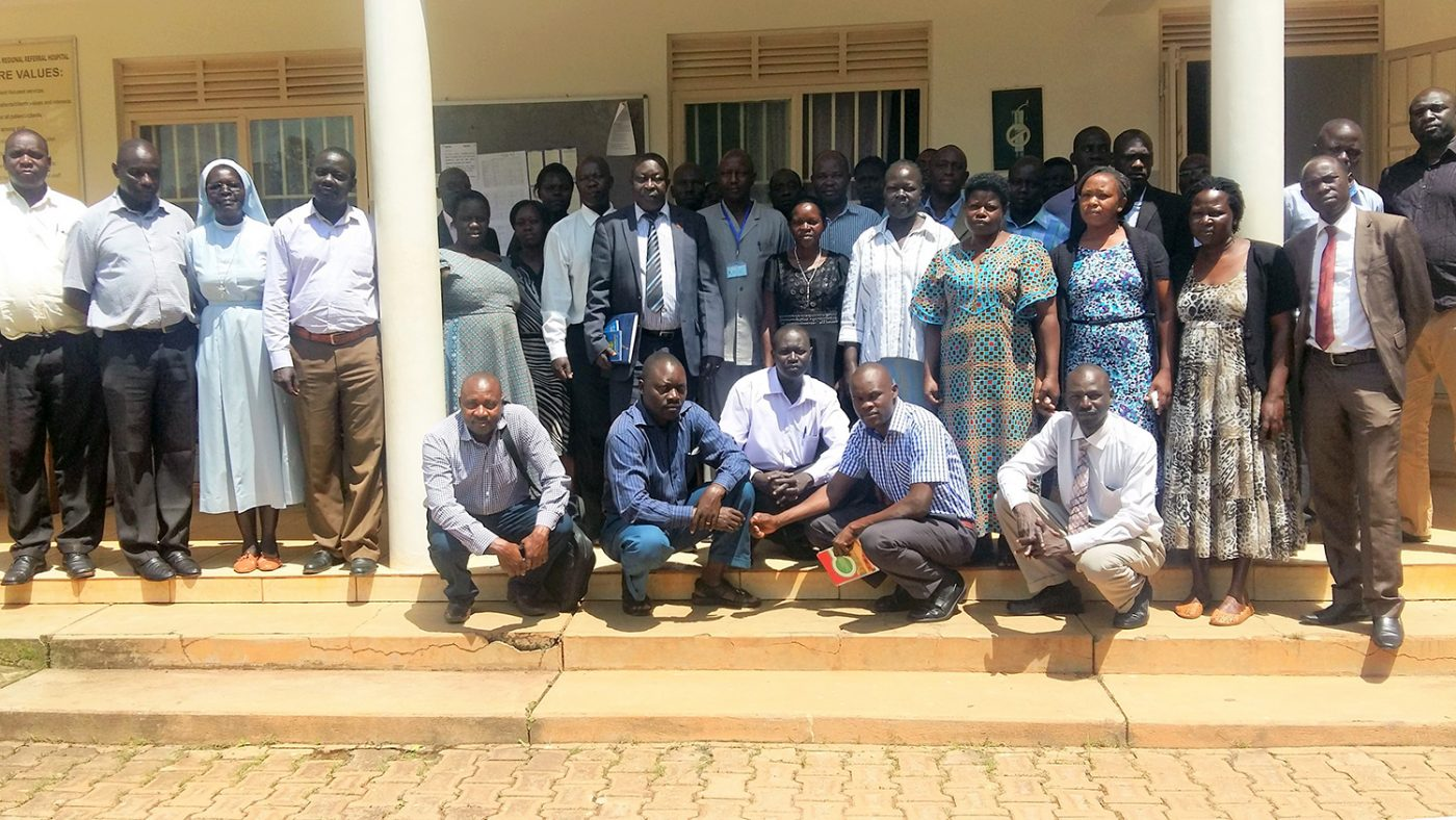 A group of doctors and health workers stand outside Lira Hospital in Uganda.