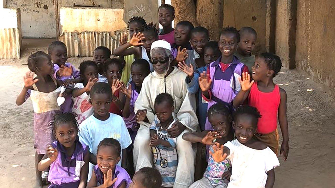 Yaya with children in the village
