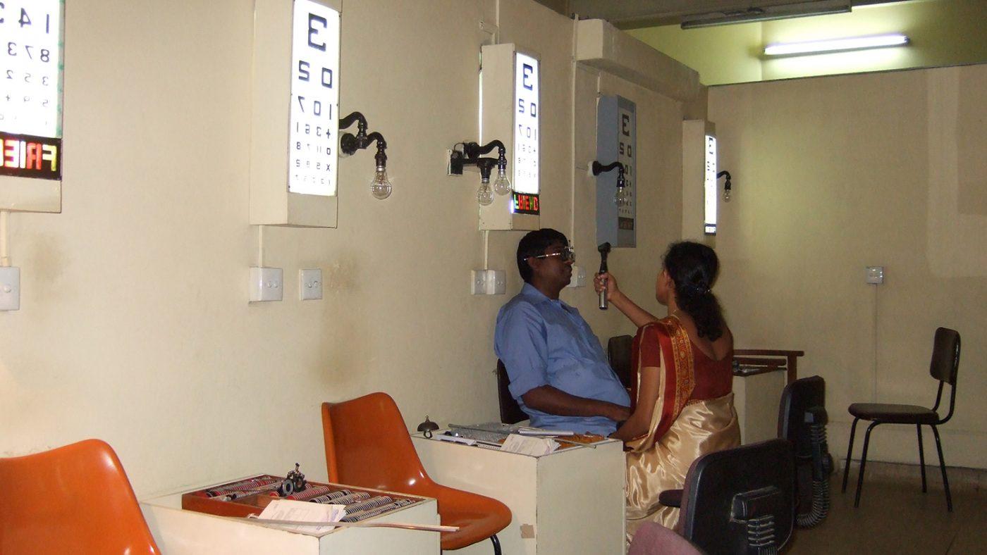 A man having an eye test in Kandy hospital.