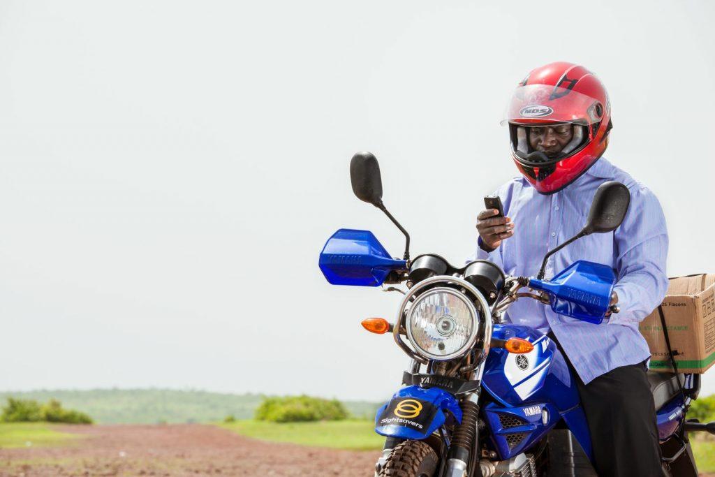 Surgeon, Yanoussi Ouologuem distrbuting medication on motorbike