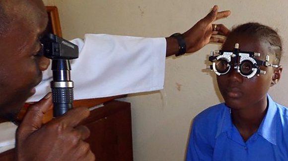 A girl having her eye sight tested.