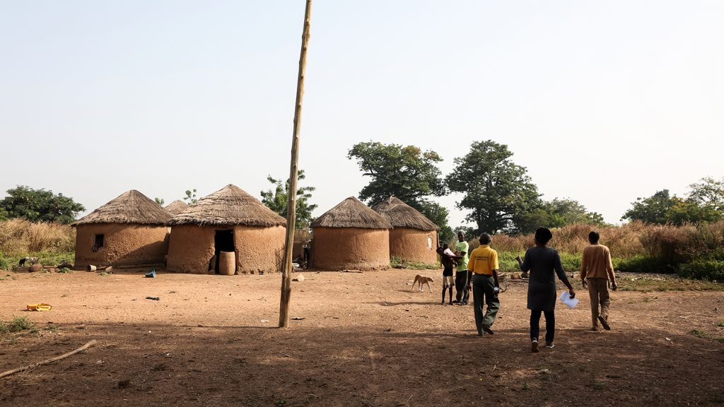 A village in the Yendi region of Ghana, featuring circular mud huts and trees.