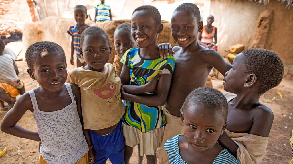 A group of boys from Yendhi district in Ghana smile for the camera.