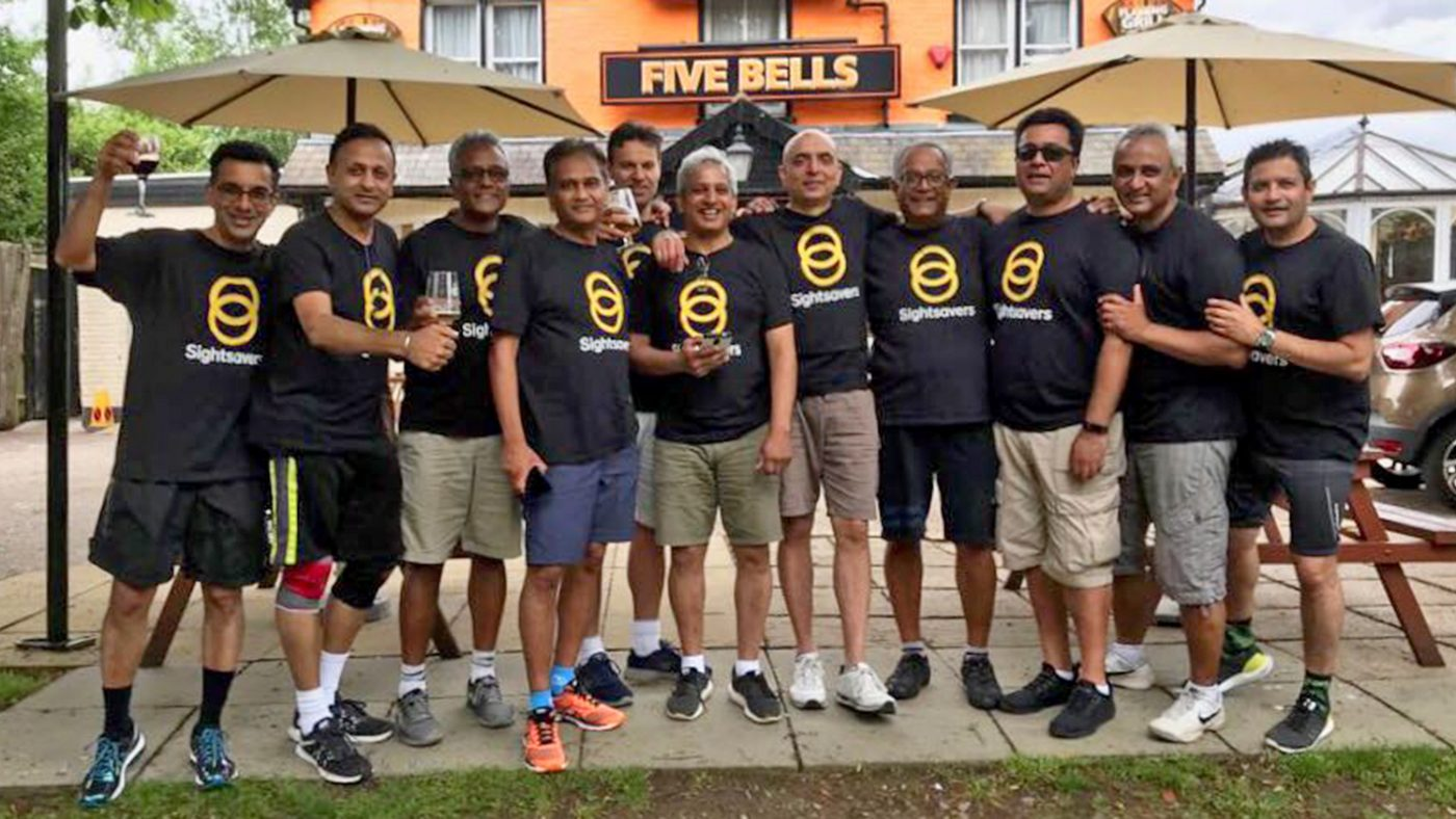 Kalpesh Patel and the other fundraisers before and during their sponsored run.