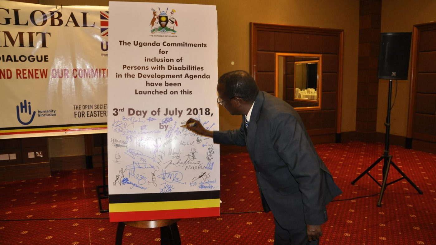 Dr Johnson Ngorok signs up to the Ugandan commitments that will be submitted at the Global Disability summit.