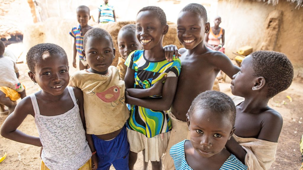 Children smile at the camera after the final trachoma treatment campaign in Yendi, northern Ghana.