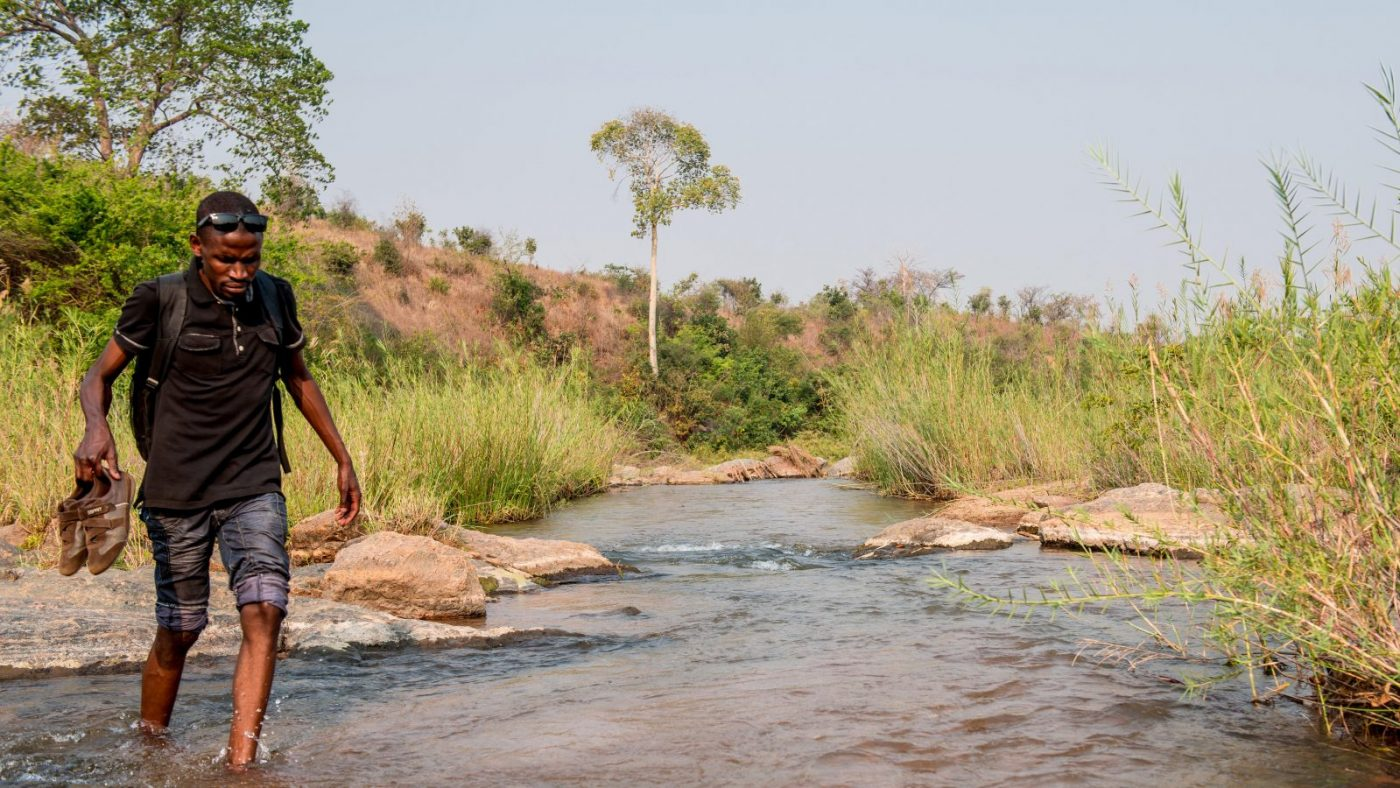 Madalitzo Nyangulu walking across a stream.