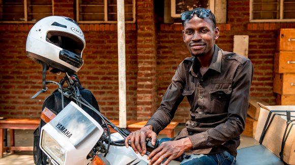 Madalitso Nyangulu sitting on his motorcycle.