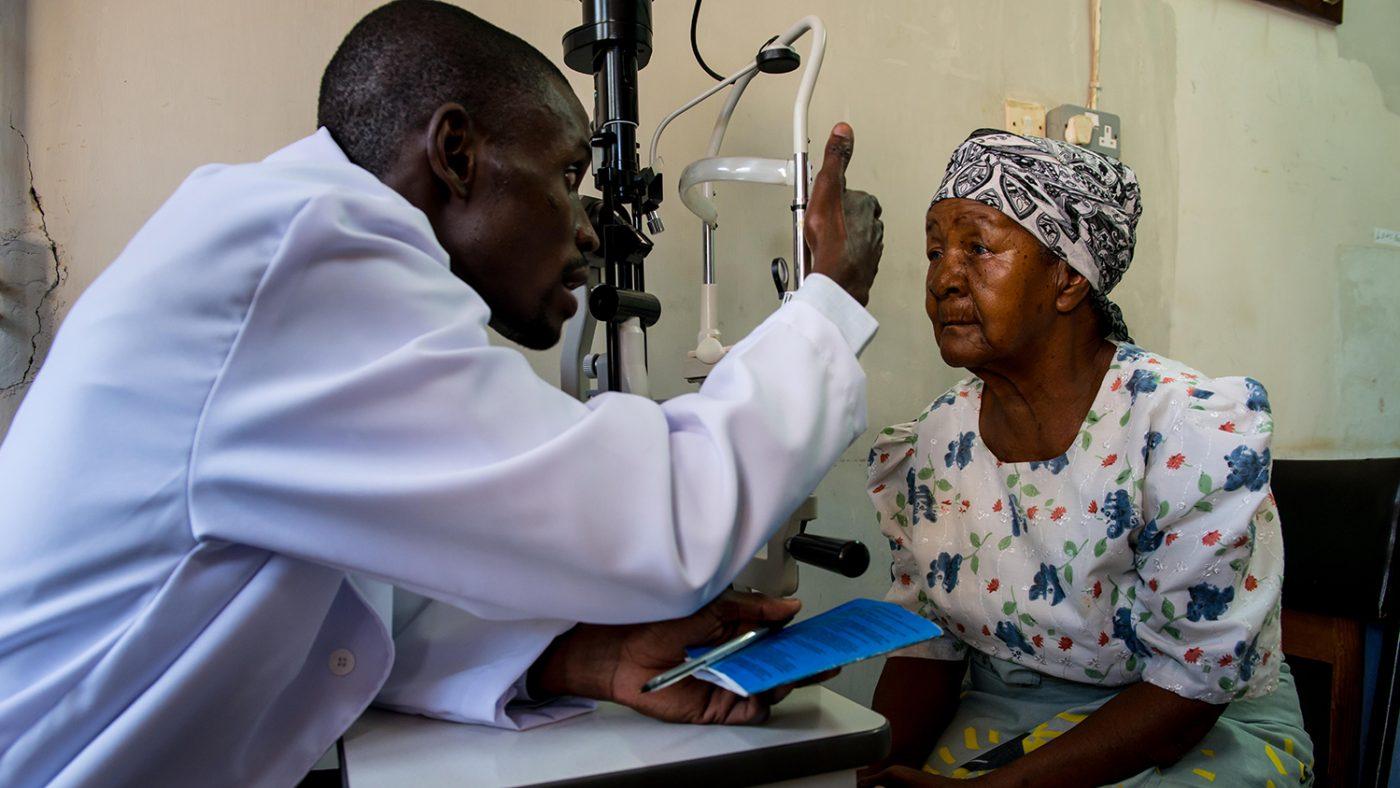 Madalitzo Nyangulu examining a lady's eye.