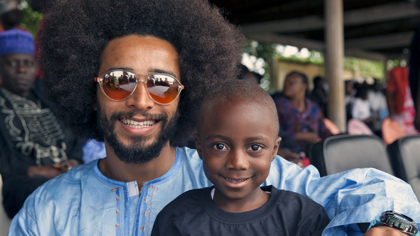 Footballer Benoit Assou-Ekotto during a visit to one of Sightsavers' programmes in Cameroon.