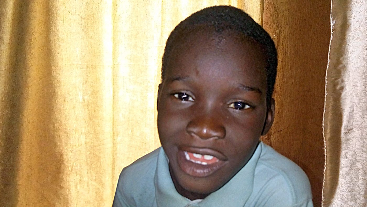 Usman smiles, his eyes are no longer clouded by cataracts.