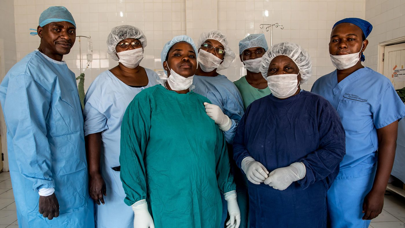 The medical team posing for the camera in their scrubs.