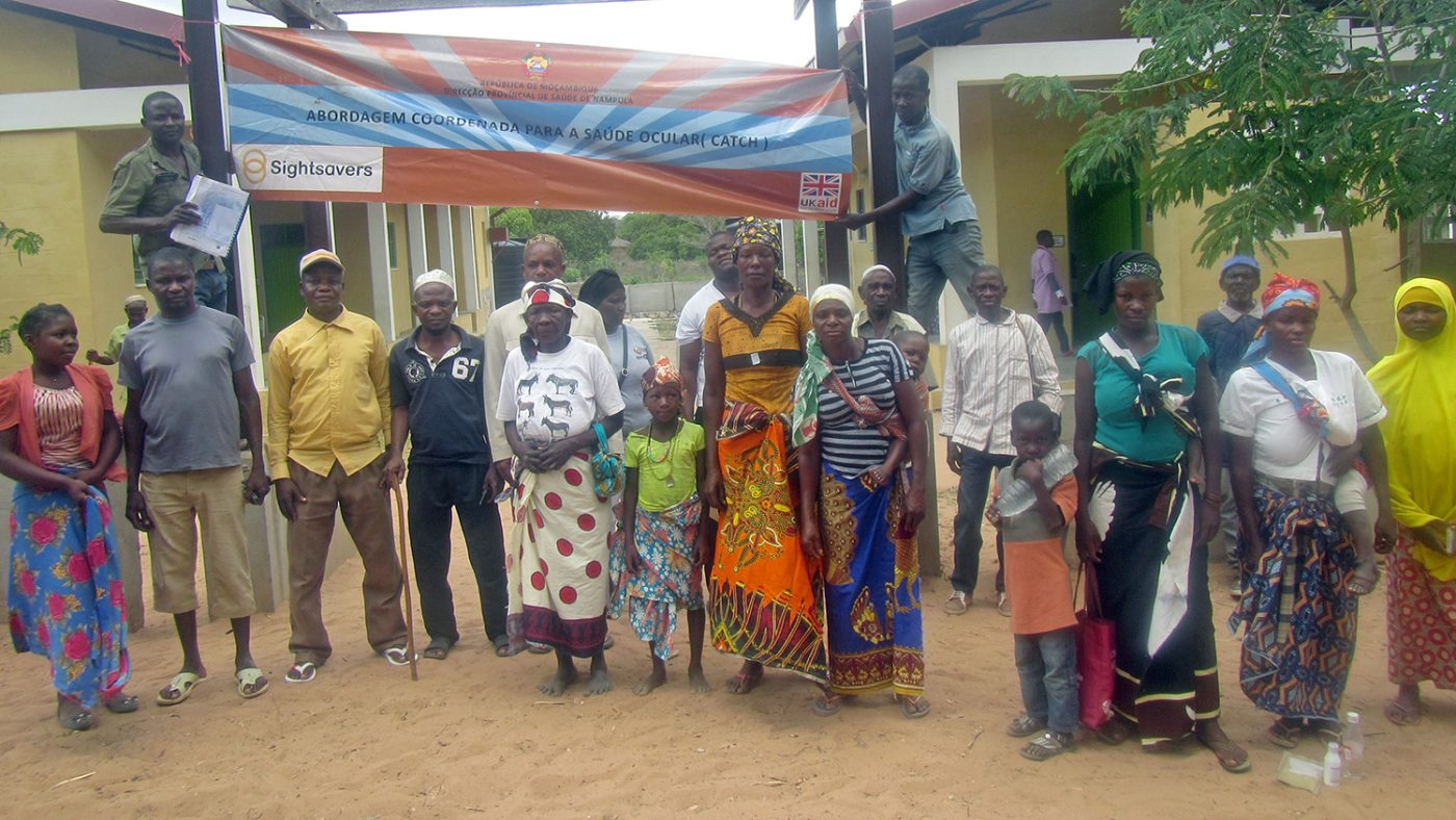 A group of patients stand outside the camp.