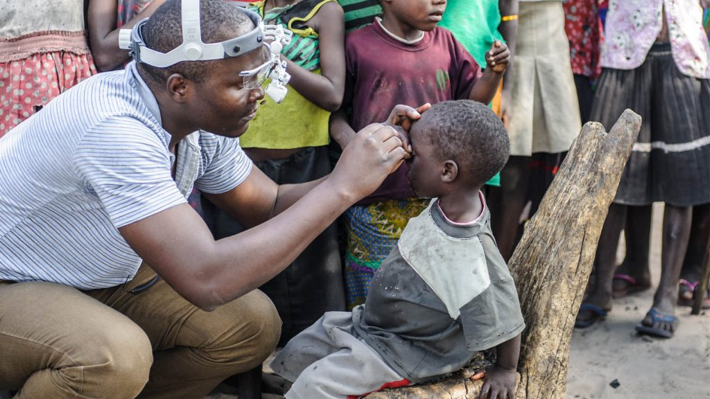 Pumelo having his eyes screened for trachoma.
