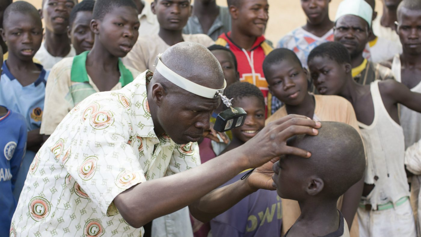 A Sightsavers supported doctor examines Abdu's eyes