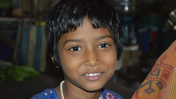 Nine year old Sonali smiles to camera
