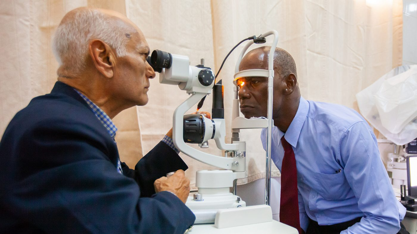 Staff at the eye clinic test the new equipment.