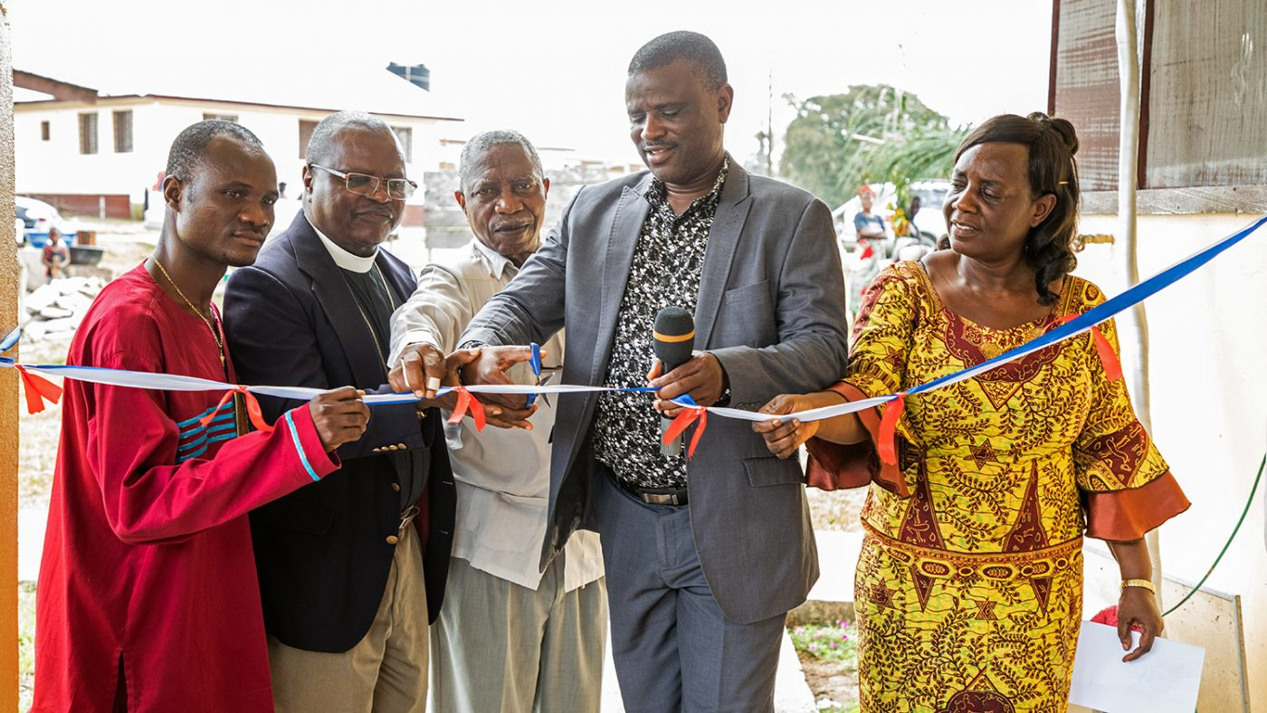 Officials cut the ribbon at the opening of the clinic.