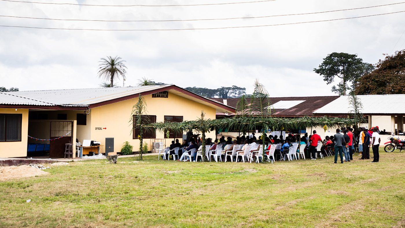 Guests listen to speakers outside the clinic during the launch event in November 2018.
