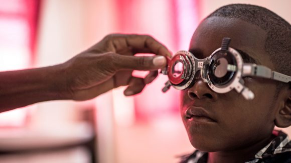 A boy in Zanzibar wears special specs to have his eyes tested.