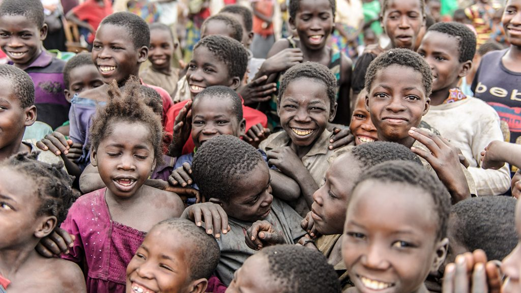A group of smiling children from western Zambia.