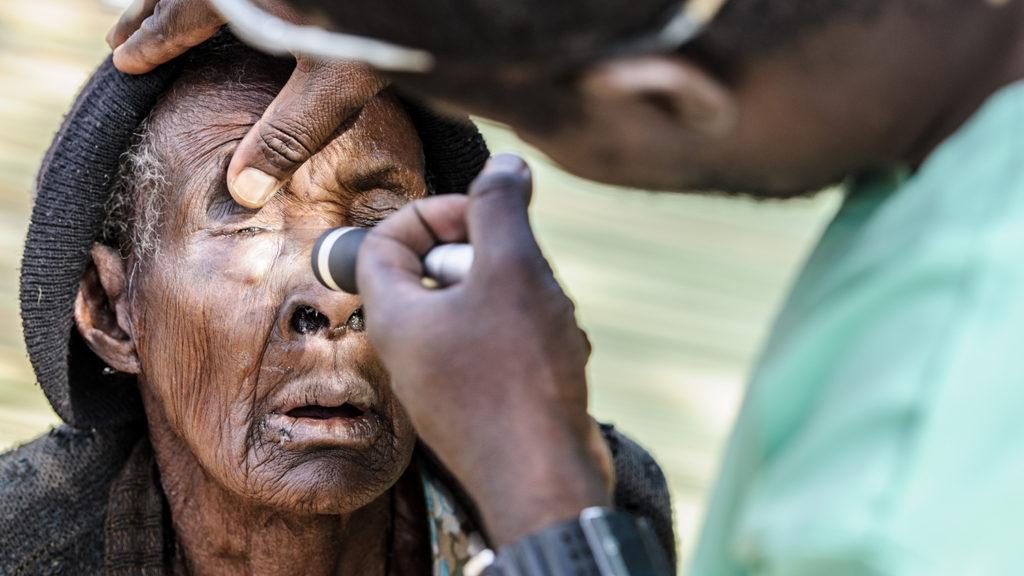 Mr Ndalela examines Namakau's eyes.