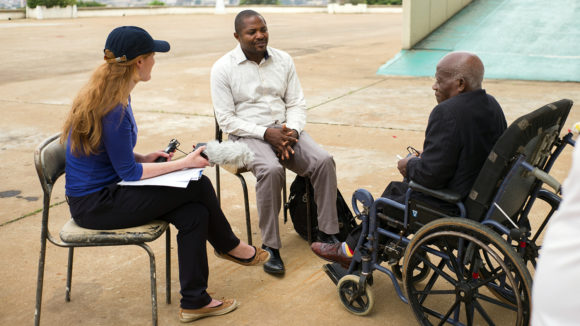Cameroon Senator Robert Oyono, the first in the country with a disability, holds a discussion with local officials and Sightsavers staff.