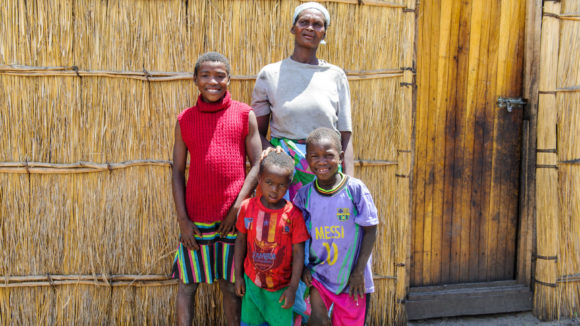 Namangola with her children at home. All four of them have had treatment for blinding trachoma.