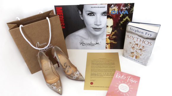 A collection of the items that Sightsavers is auctioning, including signed shoes, records and books.