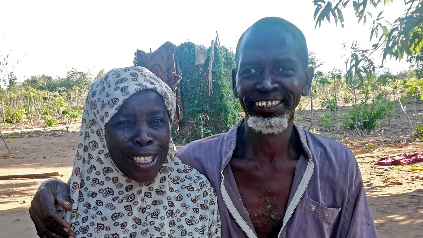 A man and a woman smiling.
