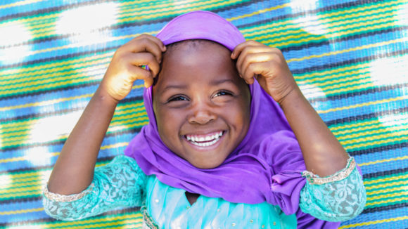 A life transformed! Filly smiles after receiving treatment for trachoma in Tanzania