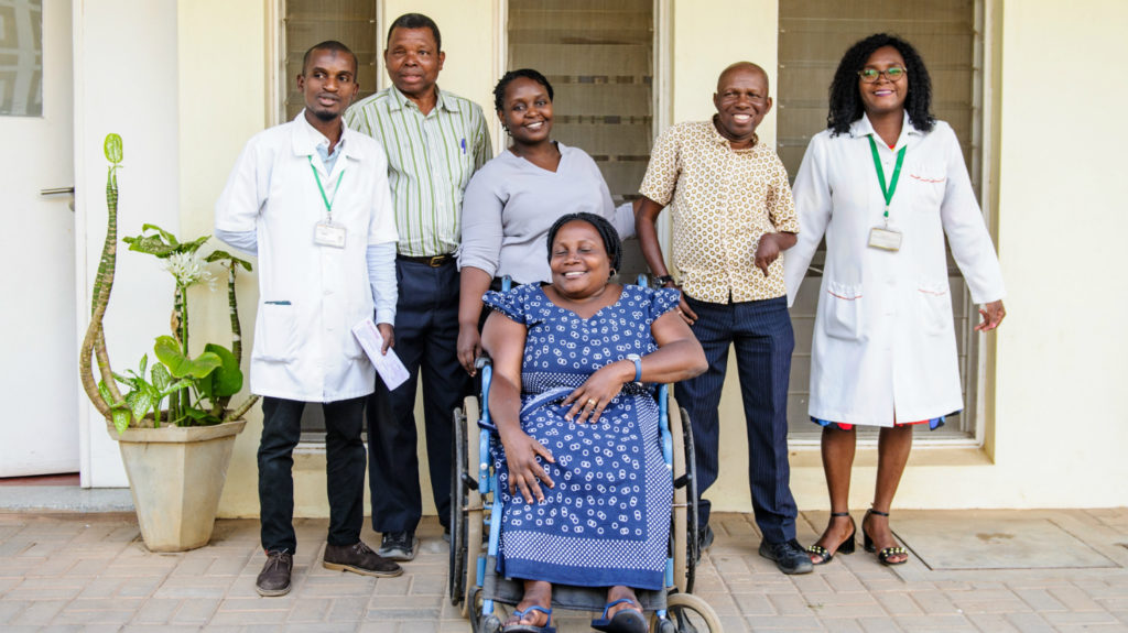 Disabled People's Organisation leaders, Sightsavers staff and medical practitioners workers outside a hospital along with Camilo Morreira.