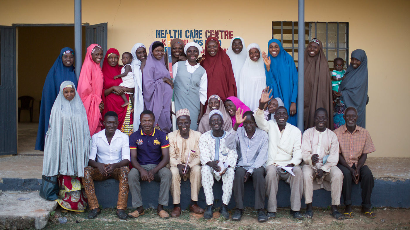 Community designated distributors in Kaduna State, Nigeria pose for a photo outside the local health centre.