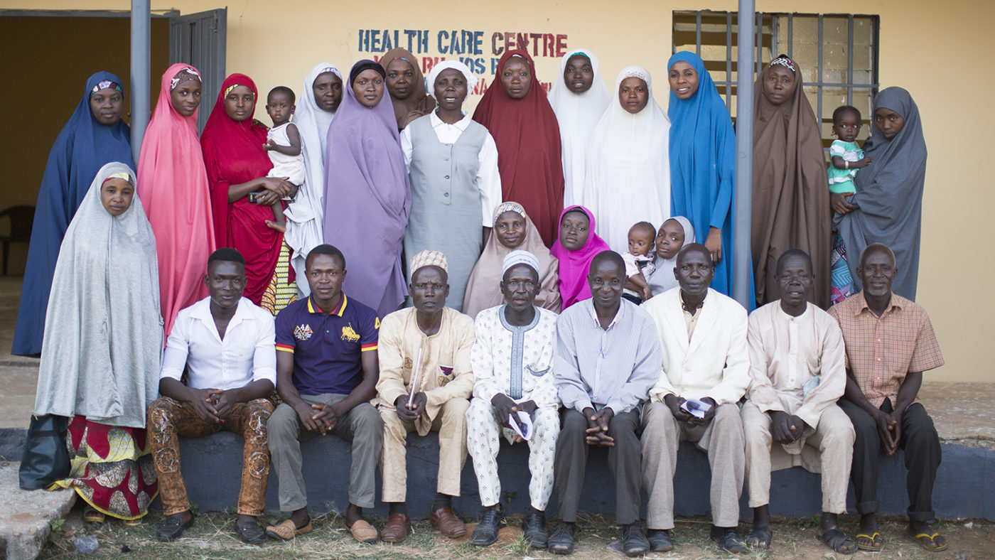 A group of volunteers pose for a photo after a training course