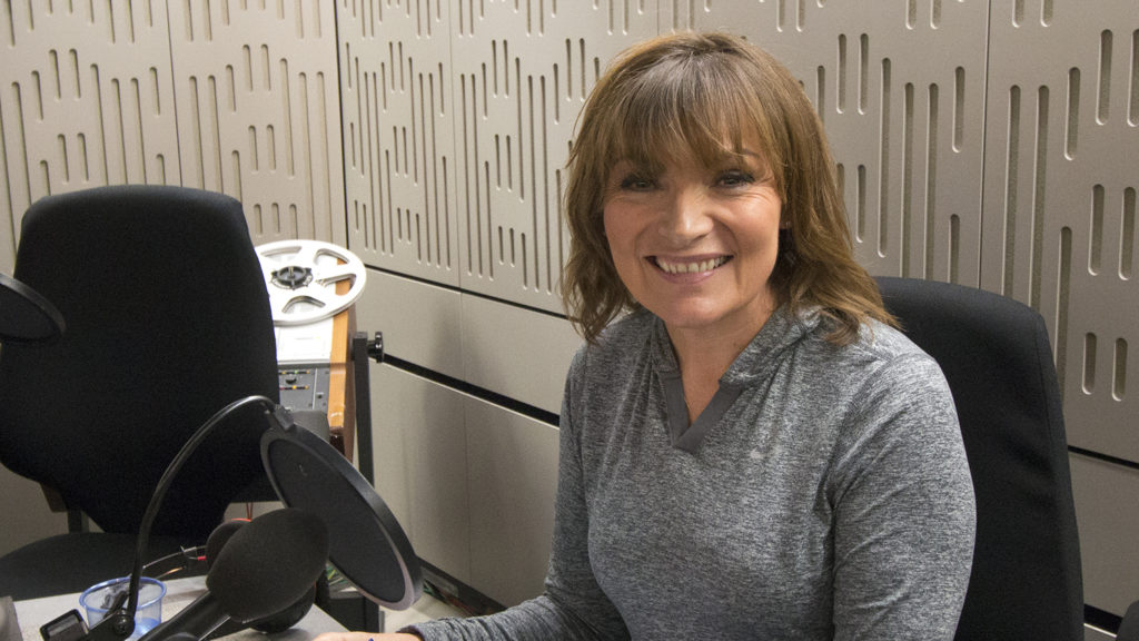 Lorraine Kelly smiles in the radio studio during the Sightsavers Radio 4 campaign.