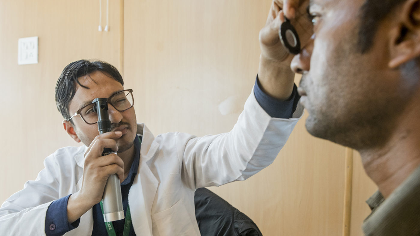 Optometrist Mohammed checks a patient's eyes.