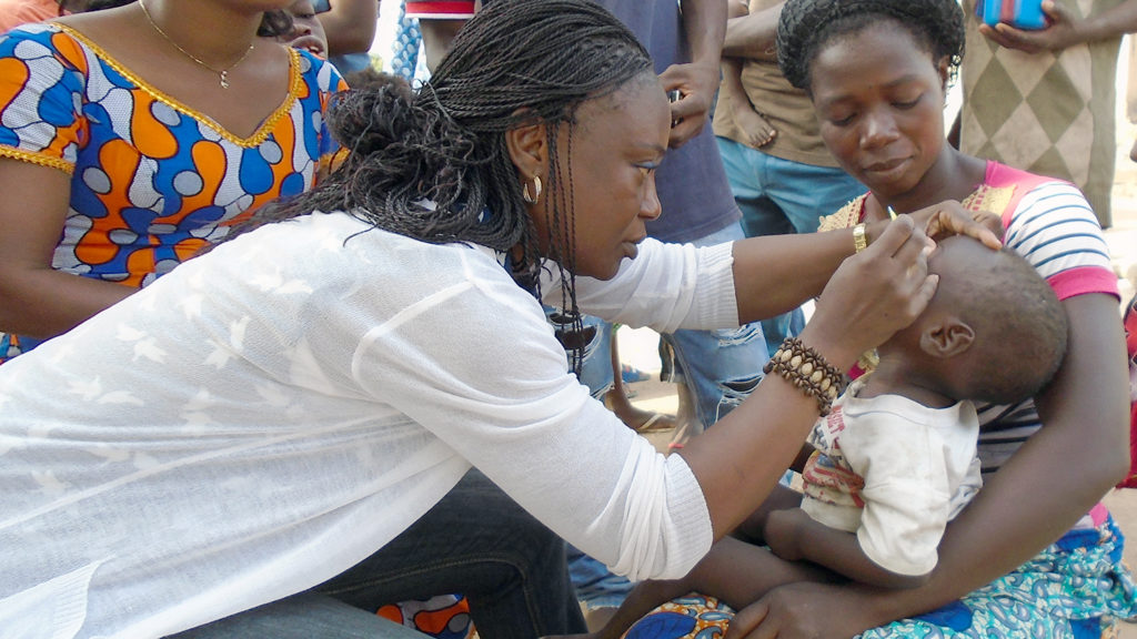 A child in Cote d'Ivoire has their eyes checked for signs of trachoma.
