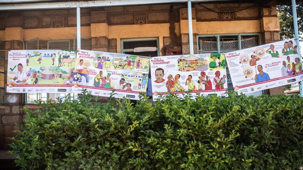 Educational posters displayed at the school, featuring messages such as 'What is trachoma?'