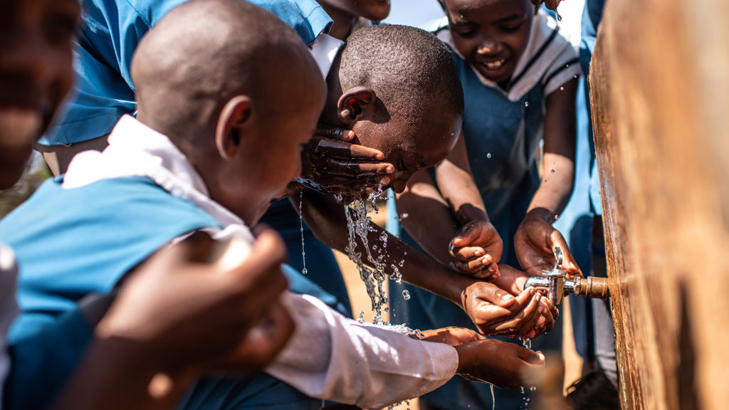 Students wash their hands at school in Kenya.