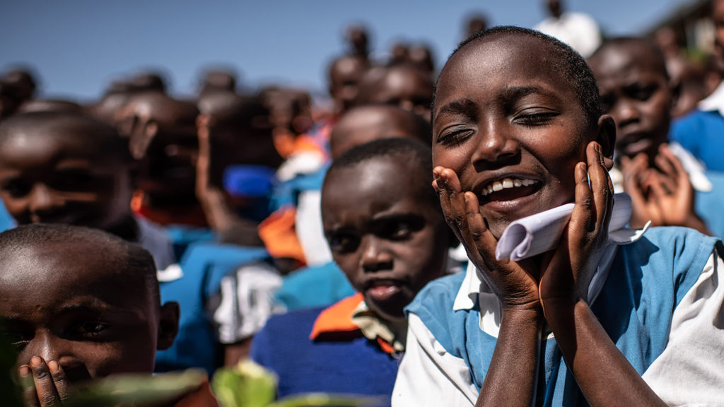 Peace, a student at Antuanduru Primary School, sings a song that helps her remember how to wash her hands and face