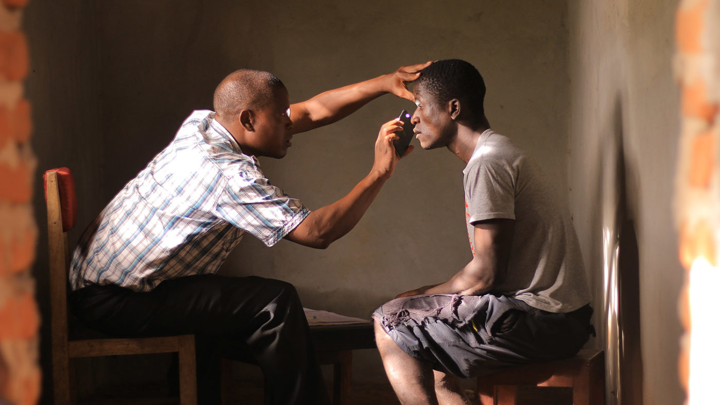 A man has his eyes checked at a screening camp in Kasungu, Malawi