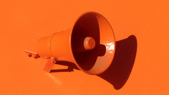 A bright orange megaphone.
