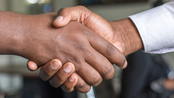 A close-up of two people shaking hands.