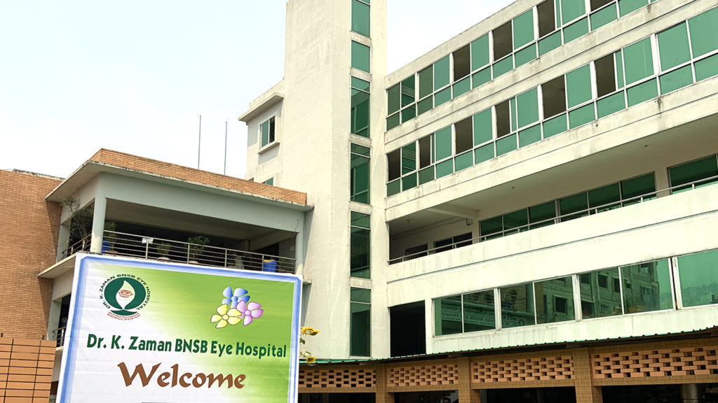 The outside of the hospital in Mymensingh. A sign says 'Welcome'.